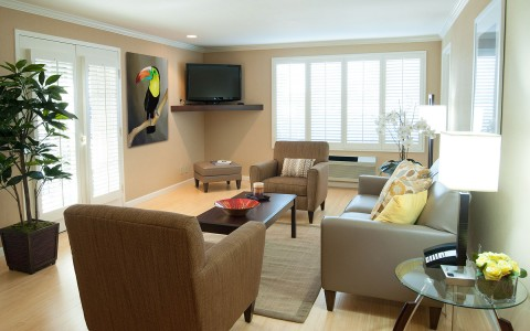 room living area with couch, chairs, coffee table, and flat screen tv and large french doors