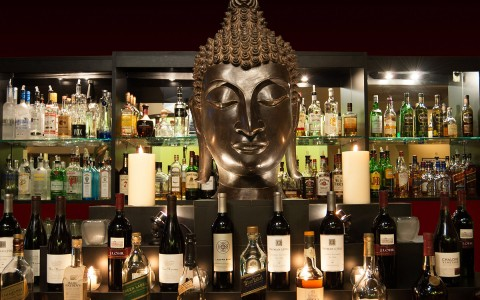 Clipper club lounge bar featuring the infamous buddha bust
