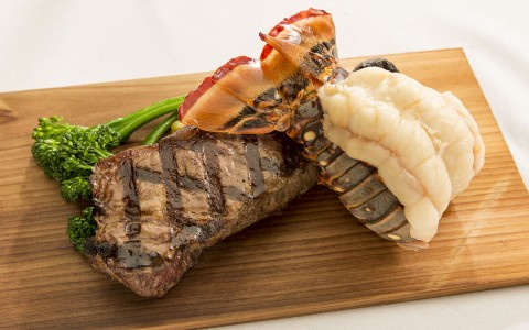 Steak with Lobster Tail & Asparagus on Cutting Board