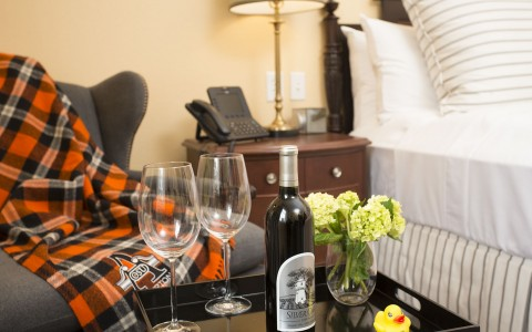 Wine and Glasses on Bedside Table