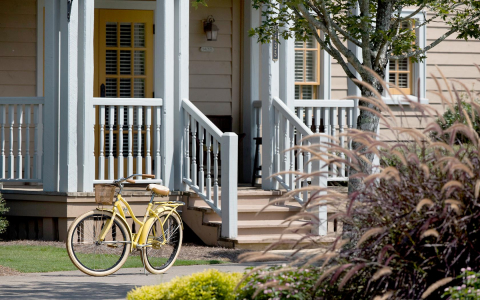 Yellow bicycle outside of house