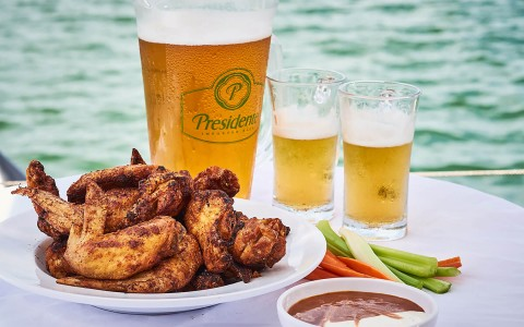 Chicken wings with beer by the water