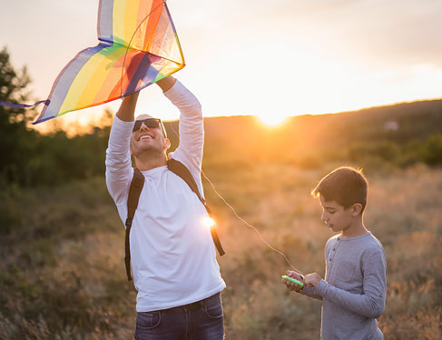 Dad and son prepping kite for flight