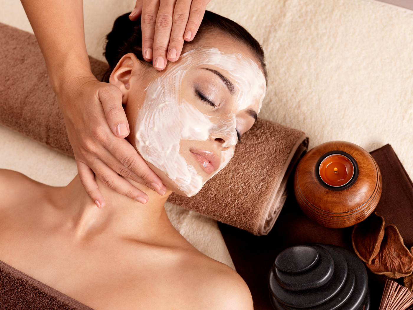 a girl enjoying a facial in a spa
