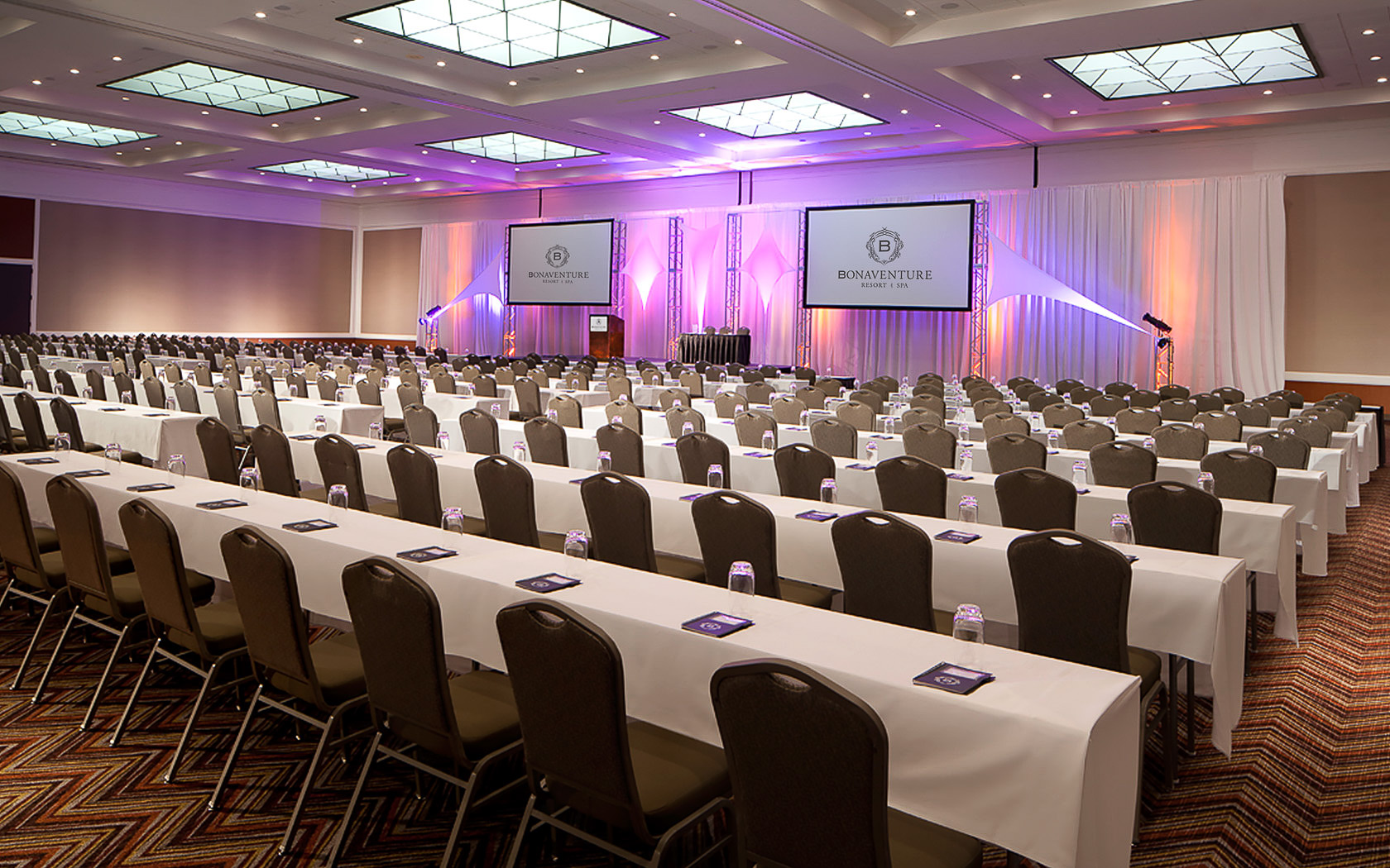 a ballroom set up for a conference