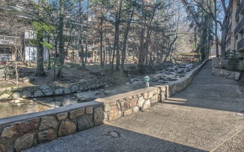 Exterior path with stone ledges & trees