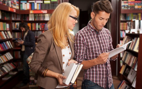 woman and man looking at a book in a bookstore