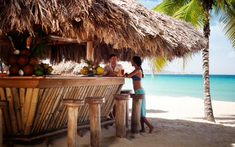Enjoy a beachside beverage, Couples Swept Away