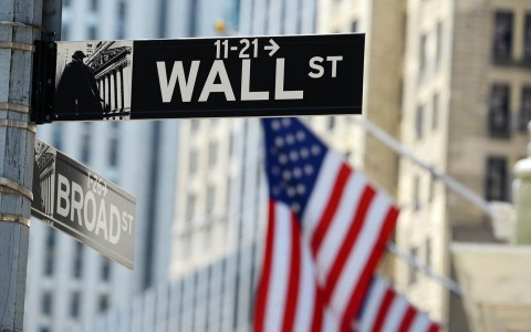 Wall Street sign with American flag