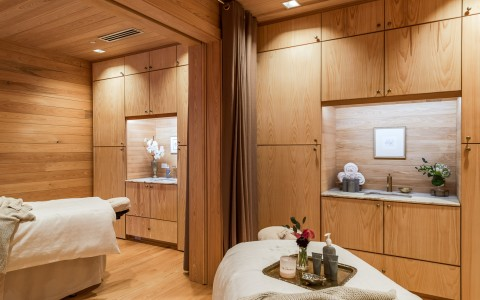 Spa with wooden walls and white beds