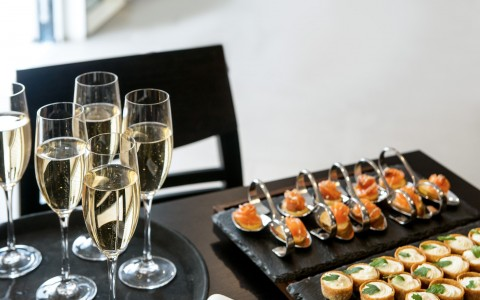 Champagne and appetizers on table
