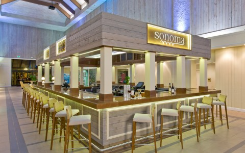 Square free-standing bar in lobby of hotel