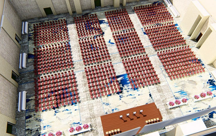 Shot of large event space from above with rows of chairs & stage