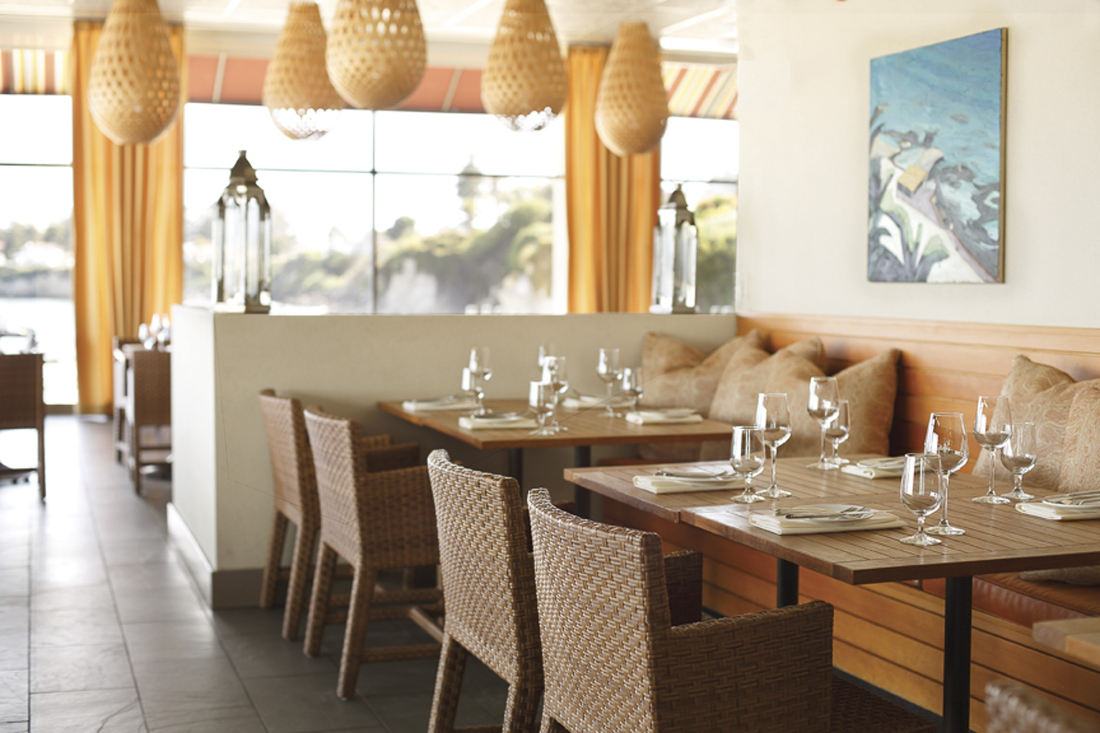 Bright Casual Dining Room With Rattan Chairs And Wooden Benches Nice Champagne Glasses