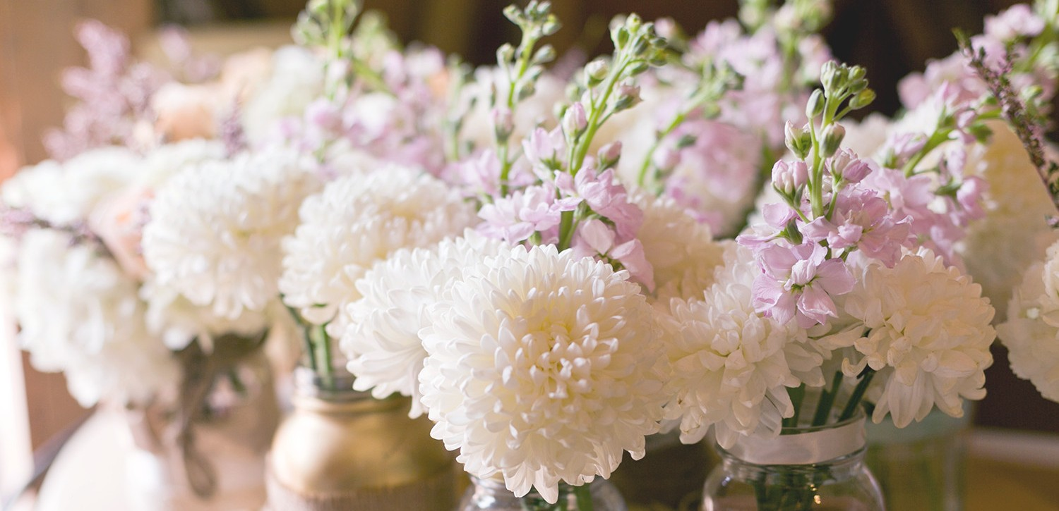 Small white & purple flower centerpieces