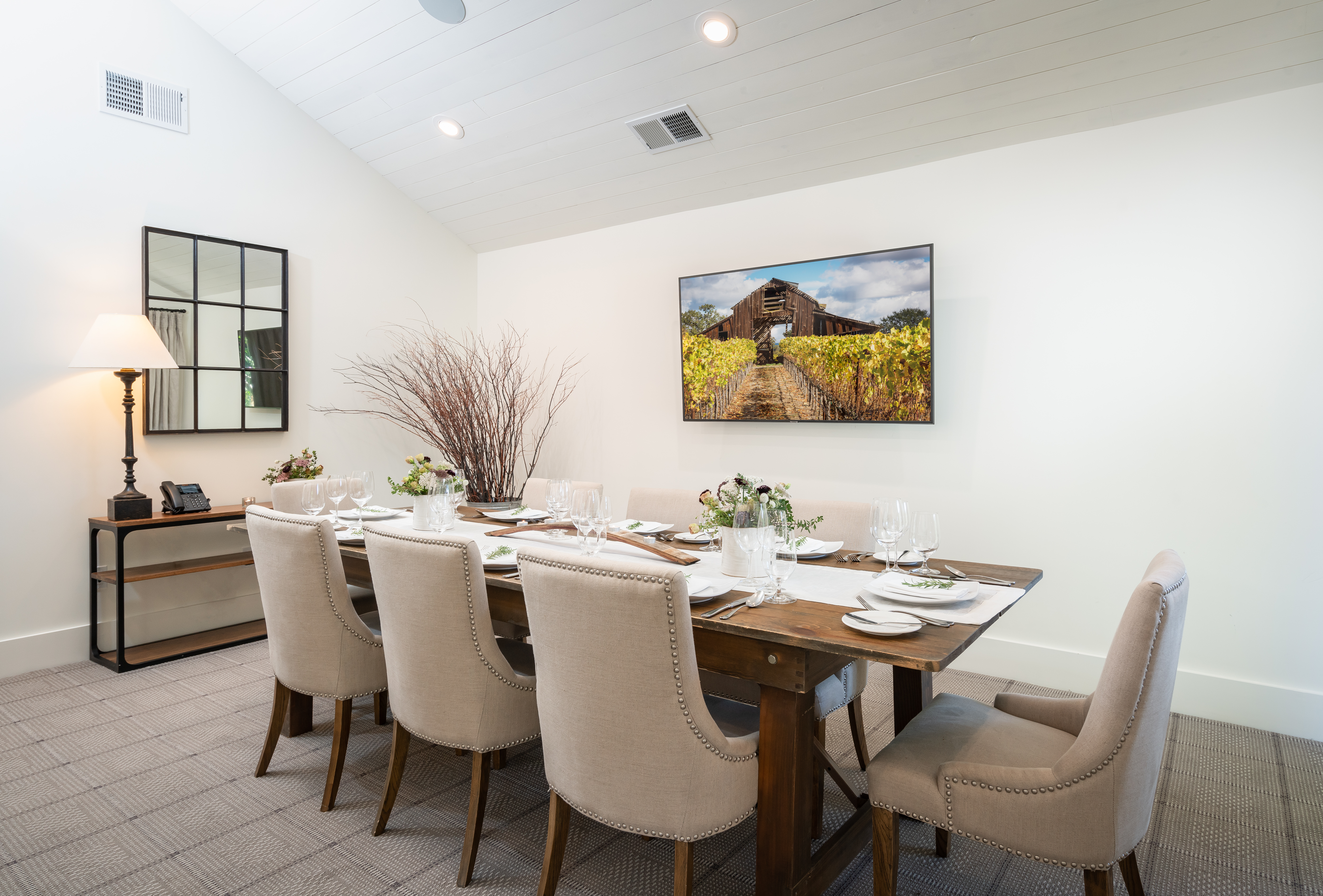 farmhouse inn grange dinner table with cream chairs and dinner place settings Inset