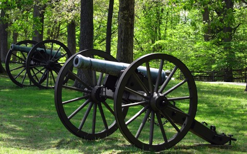 Two civil war cannons in a field