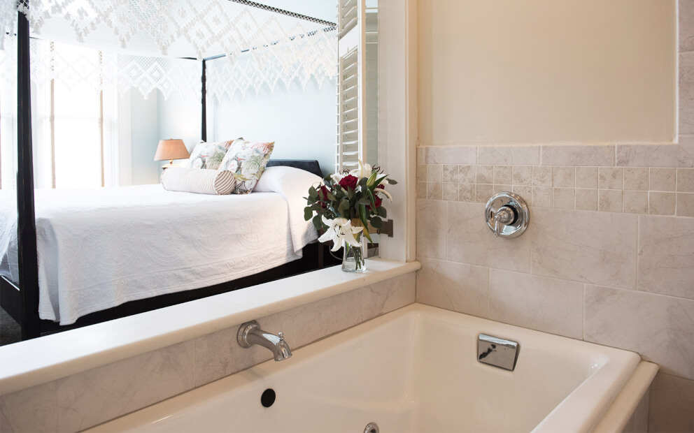 jacuzzi tub overlooking king canopy bed