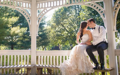 Couple kissing in gazebo