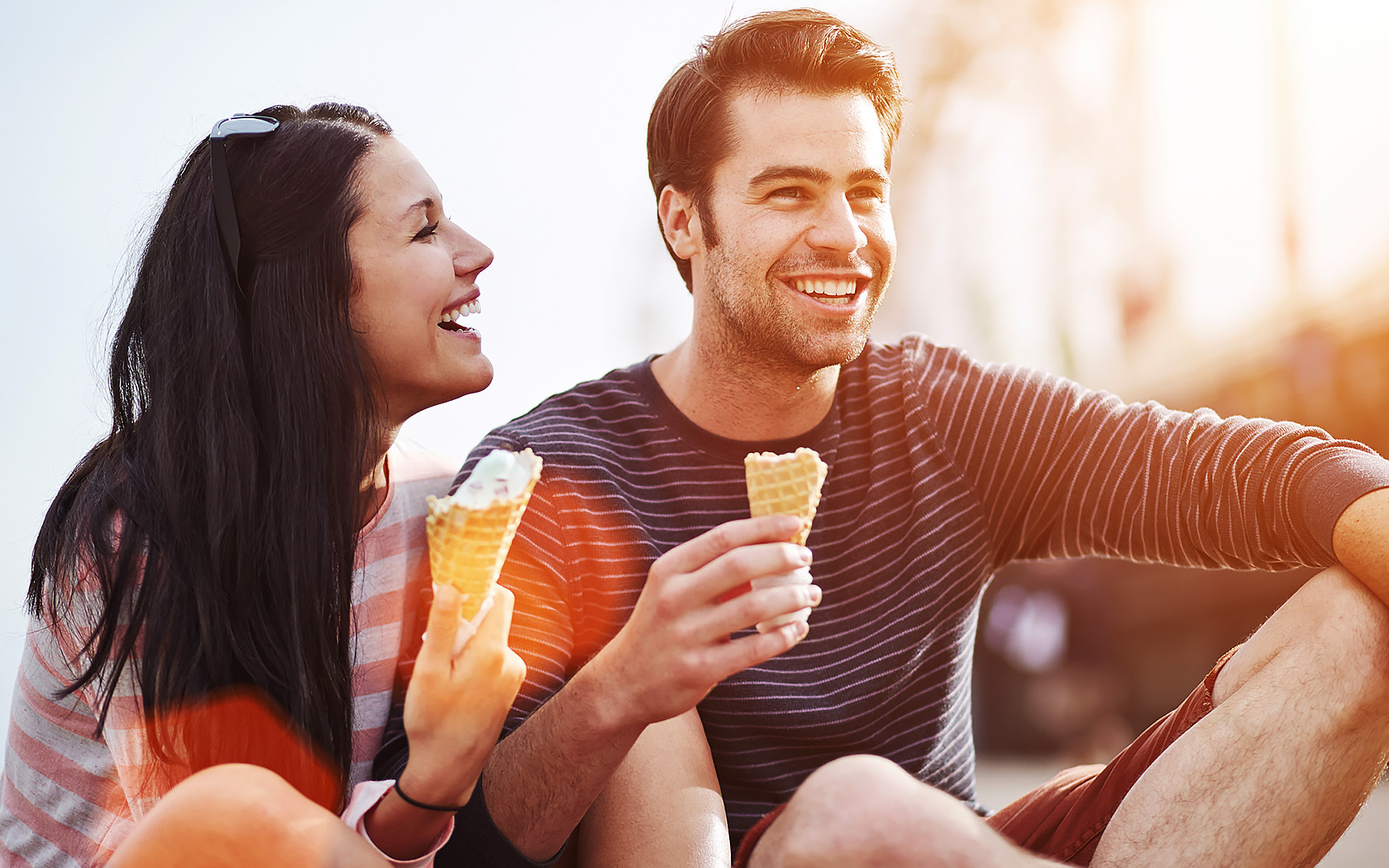 two people eating ice cream and laughing