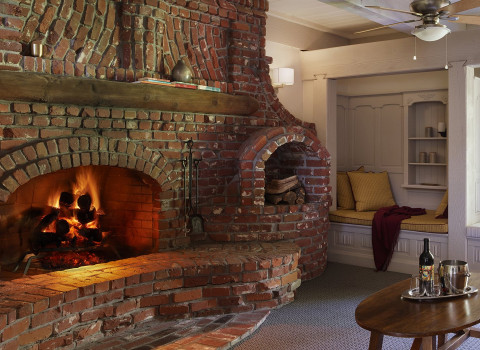 fire place and wooden carved reading nook in one of the suites