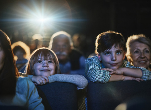 children in theater at the edge of their seats