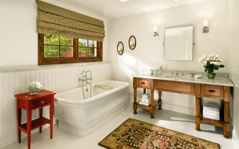 casita bathroom with rustic vanity and bath tub