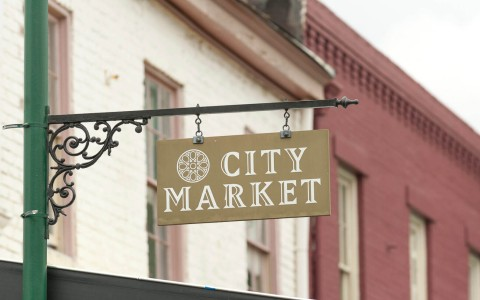city market hanging sign