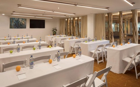 Meeting room at Amara-Cay with white table cloths