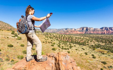 girl hiking with map