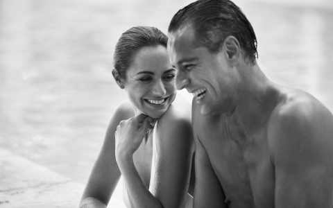 Black & white image of couple smiling