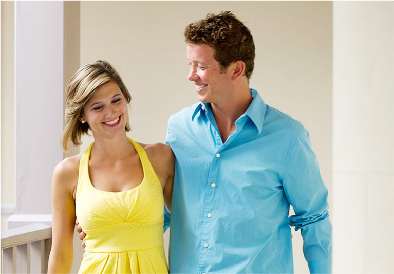 Woman in yellow dress next to man with light blue shirt