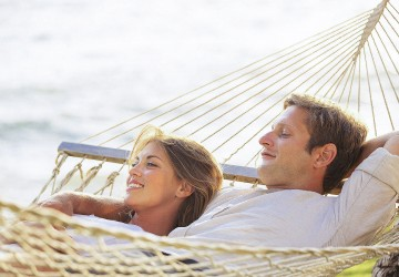 couple lounging on a hammock