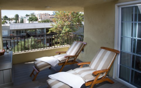 two lounge chairs on a balcony