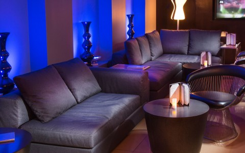 lounge seating with big square couches and drink menus