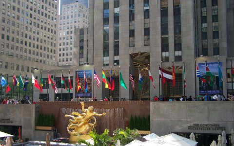 Rockefeller Center Fountain gold statue of Prometheus and row of national flags
