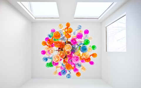 view from underneath colorful glass squiggle chandelier