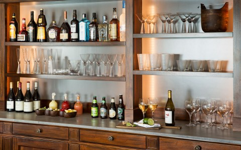 bar with bottles and glasses