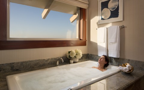 Women in bubble bath with window