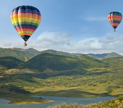 two colorful hot air balloons in the sky