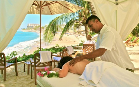 Woman getting massage in cabana