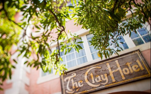 the clay hotel wooden sign above front door