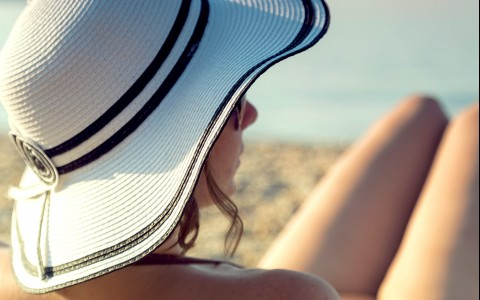 woman wearing white wide brimmed beach hat