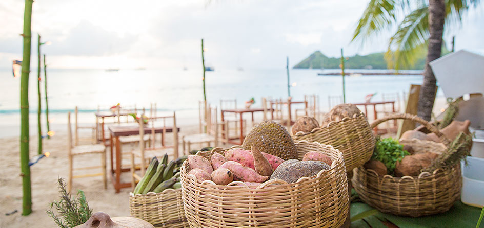 baskets of food with the ocean and island in the background
