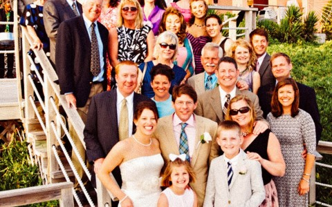 Family gathering on a stair case for a large group photo