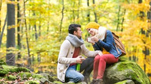 Loving couple in fall forest setting